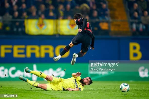 Mario Gaspar of Villarreal tackles Joao Felix of Club Atletico de Madrid during the Liga match between Villarreal CF and Club Atletico de Madrid at...
