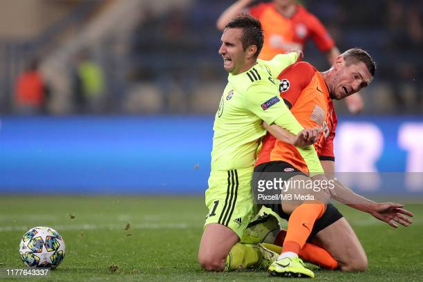 Mario Gavranovic of Dinamo Zagreb and Serhiy Kryvtsov of Shakhtar Donetsk in action during the UEFA Champions League group C match between Shakhtar...