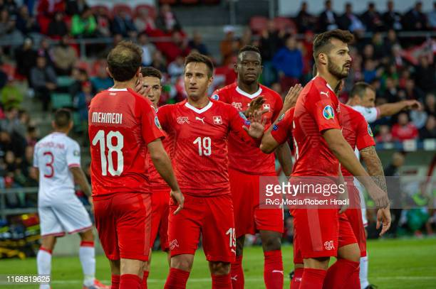 Mario Gavranovic of Switzerland celebrates his goal with teammates during the UEFA Euro 2020 qualifier match between Switzerland and Gibraltar on...