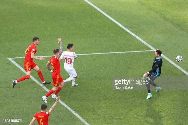 Mario Gavranovic of Switzerland scores their side's second goal past Danny Ward of Wales that is later disallowed by VAR for offside during the UEFA...