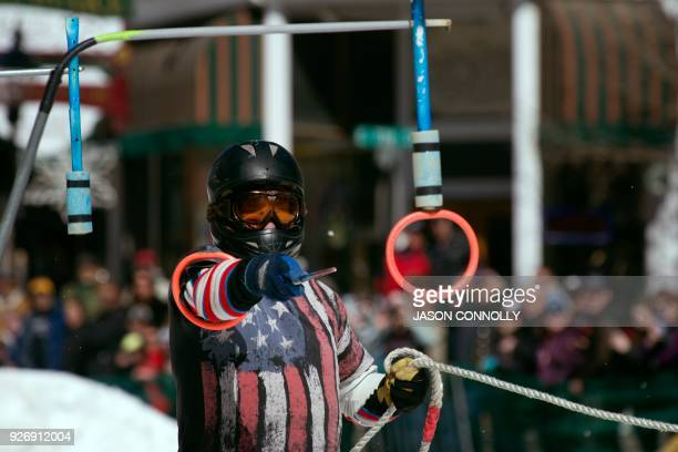 Mario Giarratano reaches for the final ring while competing in the 70th annual Leadville Ski Joring weekend competition on March 3 2018 in Leadville...