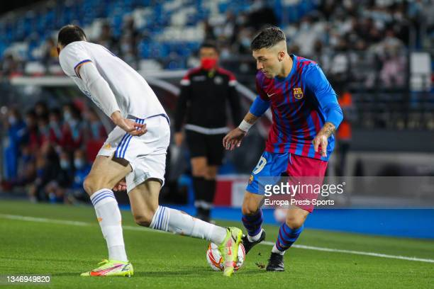 Mario Gila of Real Madrid Castilla and Antonio Aranda of FC Barcelona B in action during Primera RFEF Group 2 football match played between Real...