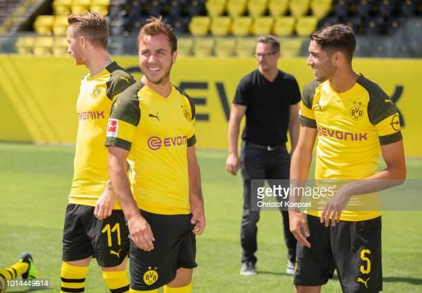 Mario Goetze and Achraf Hakimi of Borussia Dortmund look on during the team presentation at Training Ground Brackel on August 10 2018 in Dortmund...