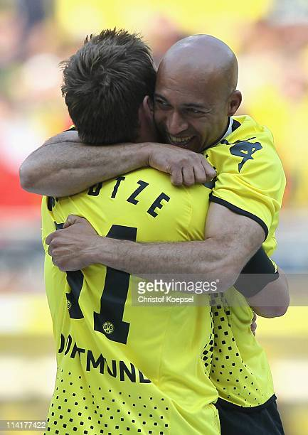 Mario Goetze and Dede of Dortmund embrace each other after winning the Bundesliga match between Borussia Dortmund and Eintracht Frankfurt at the...