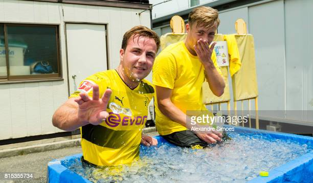 Mario Goetze and Felix Passlack of Borussia Dortmund are cooling down in the ice bath after a training session on July 16 2017 in Tokyo Japan