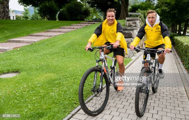 Mario Goetze and Felix Passlack of Borussia Dortmund on their way to the next training session as part of the training camp on July 27 2017 in Bad...