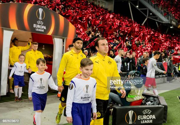 Mario Goetze and Mahmoud Dahoud of Borussia Dortmund on the way to the pitch prior to the UEFA Europa League match between FC Red Bull Salzburg and...