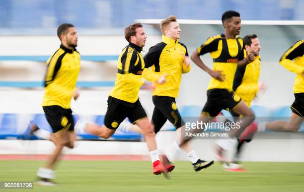 Mario Goetze and Marco Reus of Borussia Dortmund during a training session as part of the training camp at the Estadio Municipal de Marbella on...