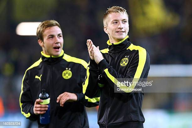 Mario Goetze and Marco Reus of Dortmund celebrate after the 10 victory of the UEFA Champions League group D match between Borussia Dortmund and Ajax...