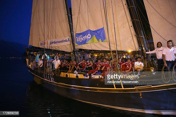 Mario Goetze and Thomas Mueller of FC Bayern Muenchen arrive with her team mates on a ship for a reception at Riva del Garda port on July 4 2013 in...