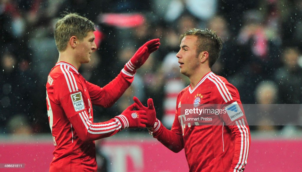 Mario Goetze (R) and Toni Kroos of Muenchen celebrate their team's second goal during the Bundesliga match between FC Bayern Muenchen and Hamburger SV at Allianz Arena on December 14, 2013 in Munich, Germany.