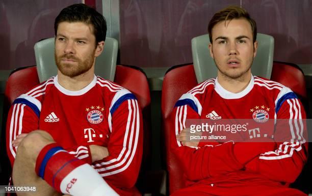Mario Goetze and Xabi Alonso of Munich are seen before the international friendly soccer match between Bayern Munich and Qatar Star at Abdullah bin...