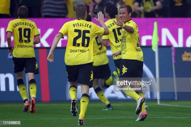 Mario Goetze celebrates the first goal of Robert Lewandowski with Lukasz Piszczek during the Bundesliga match between Borussia Dortmund and 1 FC...
