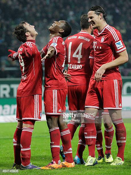 Mario Goetze celebrates with David Alaba of Bayern after scoring a goal during the Bundesliga match between Werder Bremen and FC Bayern Muenchen at...