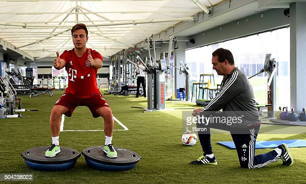 Mario Goetze is seen with Athletic coach Andreas Schlumberger during a training session with in the gym at day five of the Bayern Muenchen training...