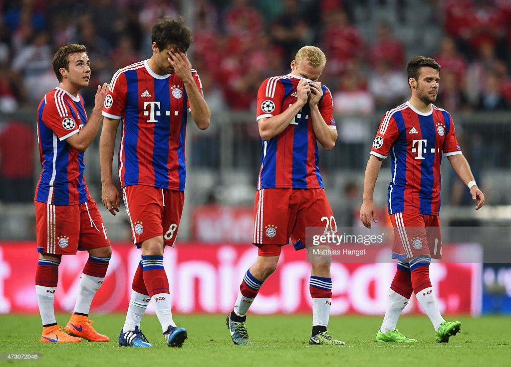 Mario Goetze, Javi Martinez, Sebastian Rode and Juan Bernat of Bayern Muenchen look on aafter elimination the UEFA Champions League semi final second leg match between FC Bayern Muenchen and FC Barcelona at Allianz Arena on May 12, 2015 in Munich, Germany.