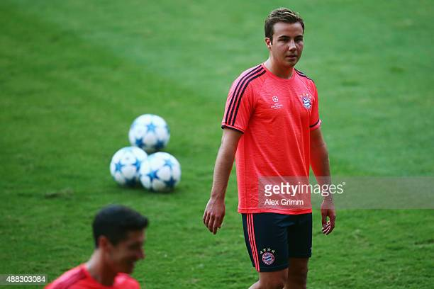 Mario Goetze looks on during a Bayern Muenchen trainiong session ahead of their UEFA Champions League Group F match against Olympiacos FC at...