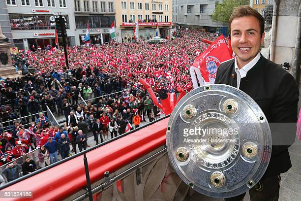 Mario Goetze of Bayern Muenchen celebrate winning the German Championship title on the town hall balcony at Marienplatz on May 15 2016 in Munich...