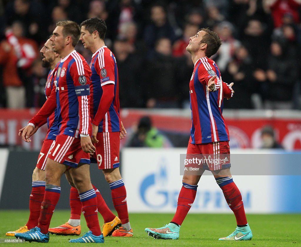 Mario Goetze (R) of Bayern Muenchen celebrates his first goal next to teammates Franck Ribery, Philipp Lahm and Robert Lewandowski (L-2ndR) during the UEFA Champions League group E second leg match between FC Bayern Muenchen and AS Roma on November 5, 2014 in Munich, Germany.