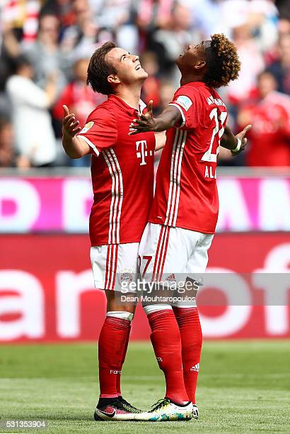 Mario Goetze of Bayern Muenchen celebrates scoring his team's second goal with his team mate David Alaba of Bayern Muenchen during the Bundesliga...