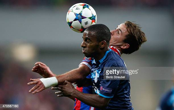 Mario Goetze of Bayern Muenchen jumps for a header with Ricardo Pereira of Porto during the UEFA Champions League Quarter Final Second Leg match...