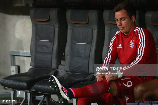 Mario Goetze of Bayern Muenchen looks on from the bench prior to the UEFA Champions League quarter final first leg match between FC Bayern Muenchen...