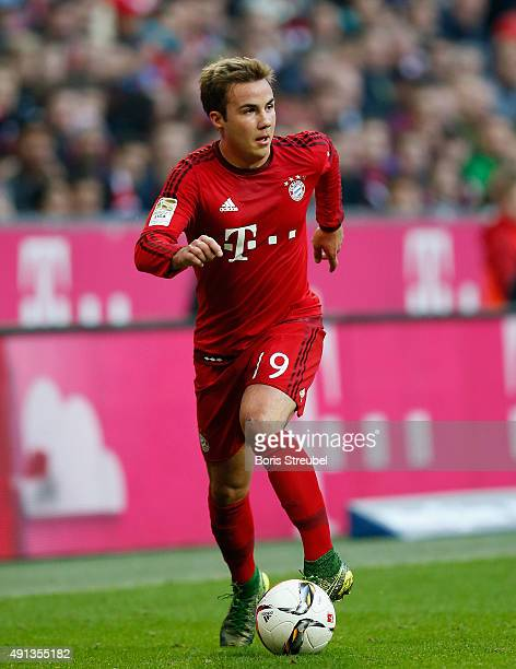 Mario Goetze of Bayern Muenchen runs with the ball during the Bundesliga match between FC Bayern Muenchen and Borussia Dortmund at Allianz Arena on...