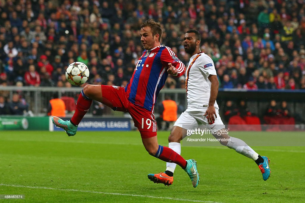 Mario Goetze of Bayern Muenchen scores their second goal as Ashley Cole of AS Roma looks on during the UEFA Champions League Group E match between FC Bayern Munchen and AS Roma at Allianz Arena on November 5, 2014 in Munich, Germany.