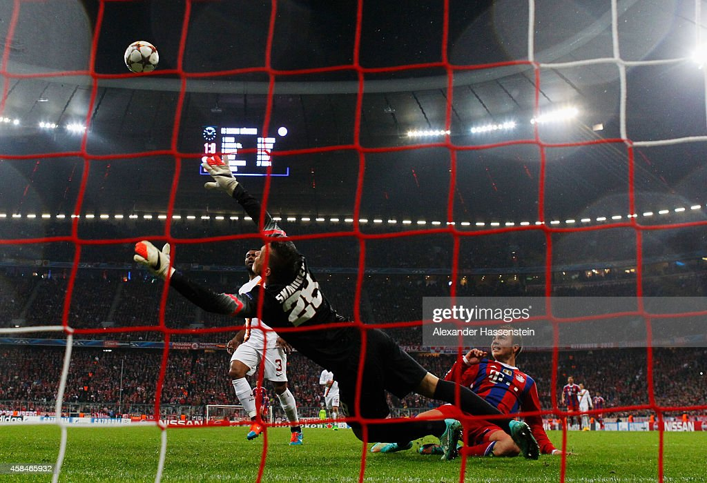 Mario Goetze of Bayern Muenchen shoots past goalkeeper Lukasz Skorupski of AS Roma to score their second goal during the UEFA Champions League Group E match between FC Bayern Munchen and AS Roma at Allianz Arena on November 5, 2014 in Munich, Germany.