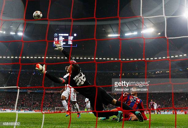 Mario Goetze of Bayern Muenchen shoots past goalkeeper Lukasz Skorupski of AS Roma to score their second goal during the UEFA Champions League Group...