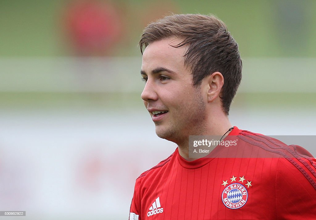 Mario Goetze of Bayern Muenchen smiles during a training session at FC Bayern Muenchen training ground on May 12, 2016 in Munich, Germany.