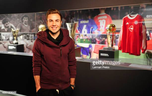 Mario Goetze of Bayern Muenchen walks through an exhibition during a media day in the FC Bayern Erlebniswelt at Allianz Arena on December 11 2013 in...
