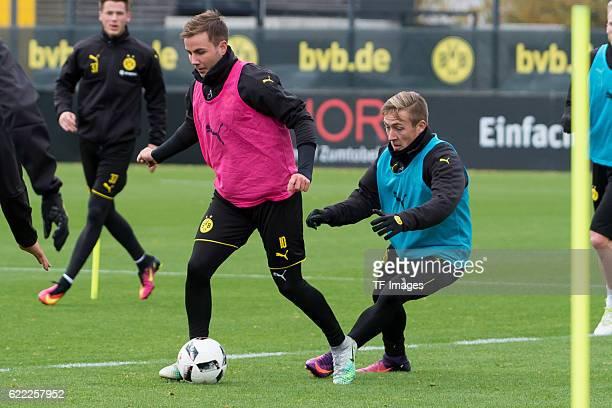 Mario Goetze of Borussia Dortmand and Felix Passlack of Borussia Dortmand battle for the ball during a training session on November 06 2016 in...