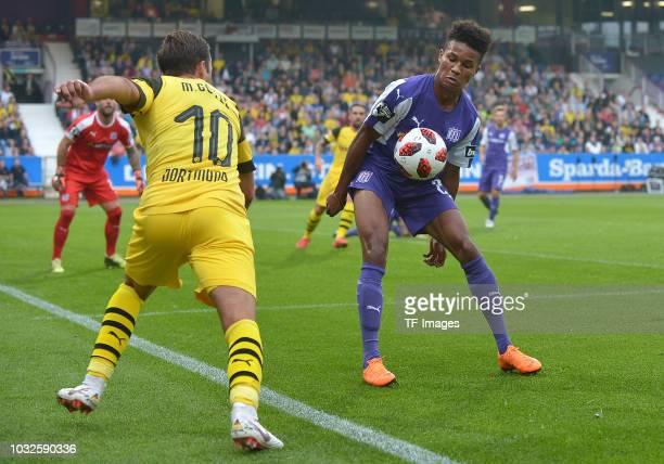 Mario Goetze of Borussia Dortmund and Felix Agu of Osnabrueck battle for the ball during the Frendly Match between VfL Osnabrück and Borussia...