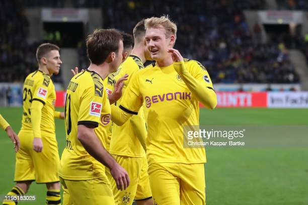 Mario Goetze of Borussia Dortmund celebrates after scoring his team`s first goal with team mate Julian Brandt of Borussia Dortmund during the...