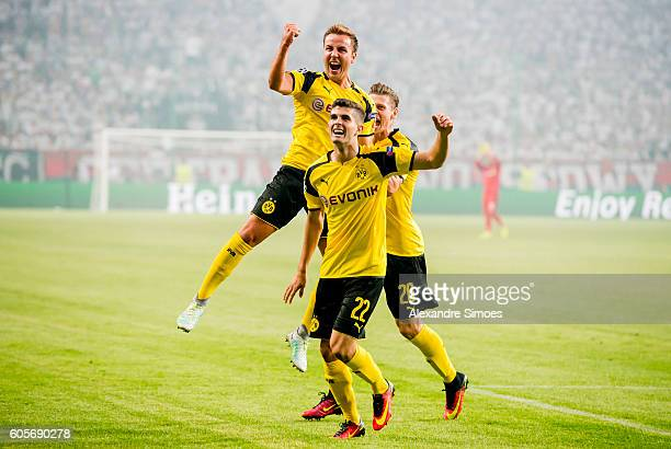Mario Goetze of Borussia Dortmund celebrates after scoring the opening goal during the UEFA Champions League Group C match between Borussia Dortmund...