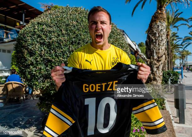 Mario Goetze of Borussia Dortmund poses with an American football jersey during an interview session as part of the training camp on January 09 2019...
