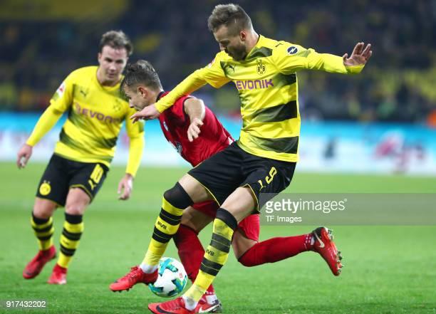 Mario Goetze of Dortmund Amir Abrashi of Freiburg and Andrey Yarmolenko of Dortmund battle for the ball during the Bundesliga match between Borussia...