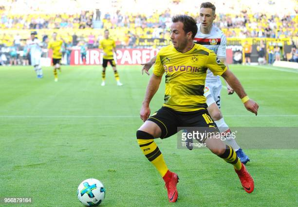 Mario Goetze of Dortmund and Dominik Kohr of Leverkusen battle for the ball during the Bundesliga match between Borussia Dortmund and Bayer 04...