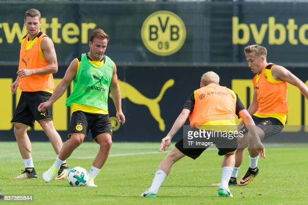 Mario Goetze of Dortmund and Felix Passlack of Dortmund battle for the ball during a training session at BVB trainings center on July 10 2017 in...
