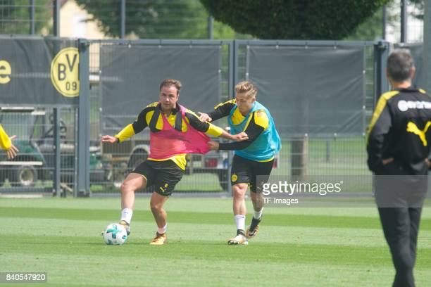 Mario Goetze of Dortmund and Felix Passlack of Dortmund battle for the ball during a training session at the BVB Training center on July 16 2017 in...