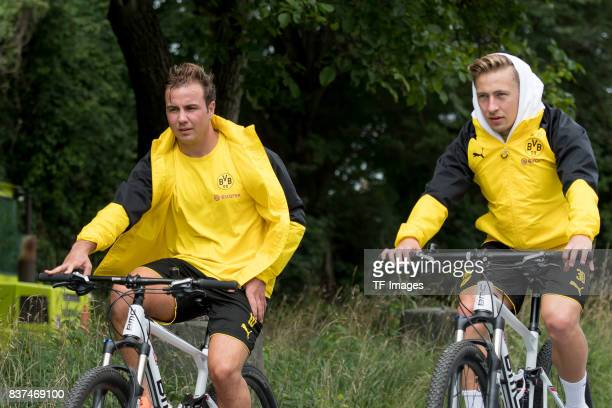 Mario Goetze of Dortmund and Felix Passlack of Dortmund on his way to the next training session as part of the training camp on July 27 2017 in Bad...