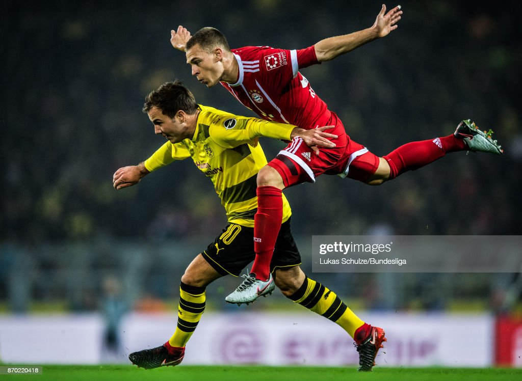 Mario Goetze (L) of Dortmund and Joshua Kimmich of Munich in action during the Bundesliga match between Borussia Dortmund and FC Bayern Muenchen at Signal Iduna Park on November 4, 2017 in Dortmund, Germany.