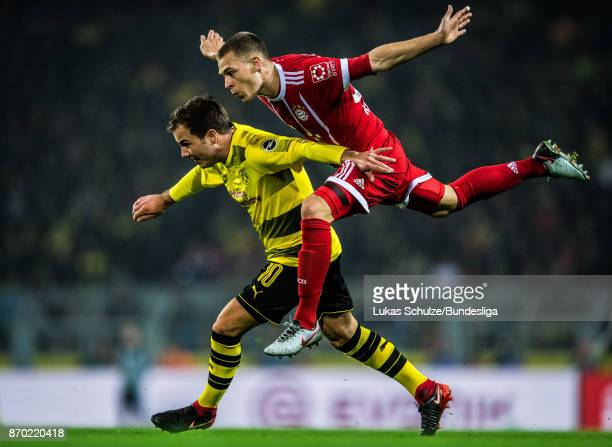 Mario Goetze of Dortmund and Joshua Kimmich of Munich in action during the Bundesliga match between Borussia Dortmund and FC Bayern Muenchen at...