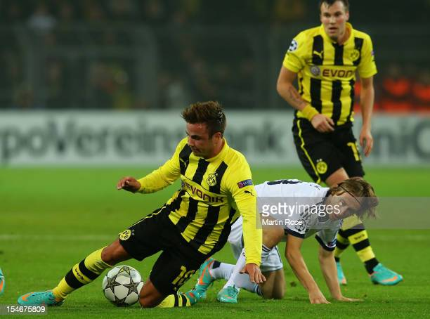 Mario Goetze of Dortmund and Luka Modric of Madird battle for the ball during the UEFA Champions League group D match between Borussia Dortmund and...