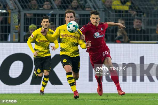 Mario Goetze of Dortmund and Marc Oliver Kempf of Freiburg battle for the ball during the Bundesliga match between Borussia Dortmund and SportClub...