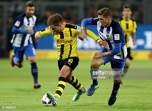Mario Goetze of Dortmund and Niklas Stark of Berlin battle for the ball during the Bundesliga match between Borussia Dortmund and Hertha BSC at...