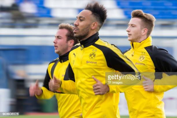 Mario Goetze of Dortmund Auba PierreEmerick Aubameyang of Dortmund and Marco Reus of Dortmund run during the Borussia Dortmund training camp at...