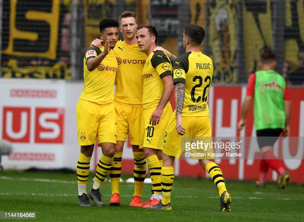 Mario Goetze of Dortmund celebrate with his team mates after he scores the 3rd goal during the Bundesliga match between SportClub Freiburg and...