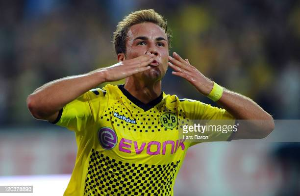 Mario Goetze of Dortmund celebrates after scoring his teams second goal during the Bundesliga match between Borussia Dortmund and Hamburger SV at...